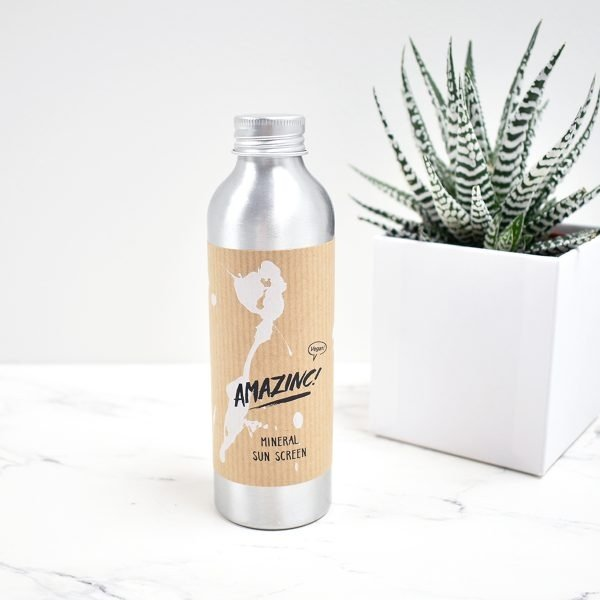 Amazinc Mineral Sunscreen Lotion Next To Plant