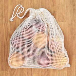 A Slice of Green Large Organic Cotton Net Produce Bag Filled With Fruit With Drawstring Closed