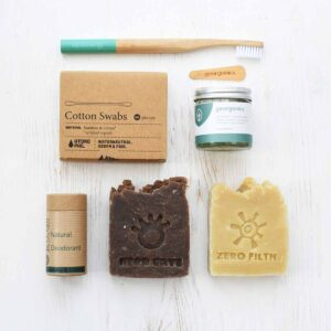 Complete Essentials Kit with bamboo toothbrush, coconut oil toothpaste, solid shampoo & soap bars, natural deodorant and cotton swabs