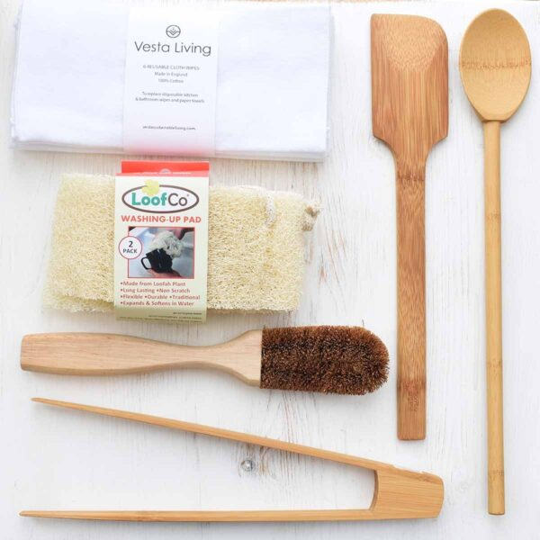 Kitchen Essentials with coconut dish brush, washing up pads, unpaper towels and a range of bamboo kitchen utensils