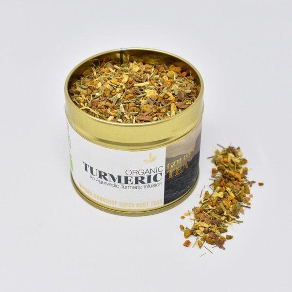 Wunder Workshop Organic Golden Turmeric Tea tin open with loose tea leaves